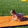 Claire decided to crawl on the slip n' slide.