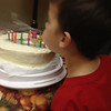 Thayden turns four and blows out the candles.