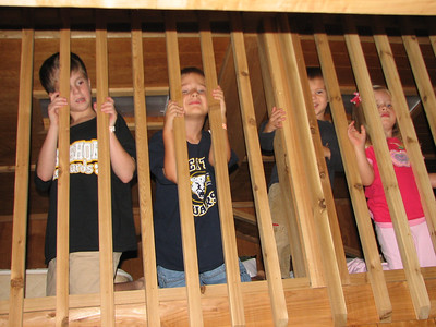 All 4 of the kids up in the loft.