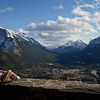 Zoe sitting on a ledge with Banff in the background.