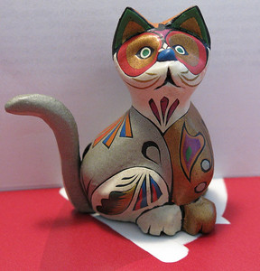 Mopa mopa craft cat. The buds of the mopa-mopa tree are boiled down to a resin, to which Minerals colors are added, stretched is placed on top of a plain, hand carved, wooden object. Intricate designs are then out into the resin with a knife, this gives it the hand painted look. The birds, butterflies, boxes and the several other forms make  non expensive souvenir, wonderful gifts, which aren't found anywhere else.
