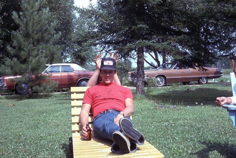 Summer 75 - at Barbers Bay cottage; Richard behind Gilles