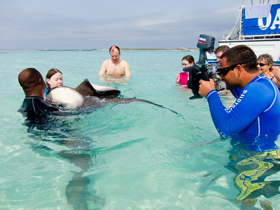 Kelley kissing a stingray off Grand Turk.