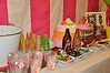 The dessert table with cake, ice cream and plenty of toppings.