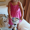 Madekins with Dad's hockey trophy.....he is the latest to take it on vacation!!