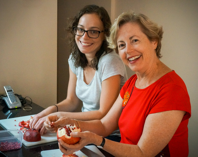 Gillian and Lauren de-seeding pomegranates to put in the punch