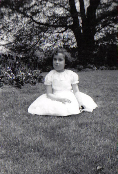 This is me on my 1st Communion Day - Note: the unruly hair is not a recent phenomena.<br /> May 1958<br /> Roger William's Park, Providence, RI