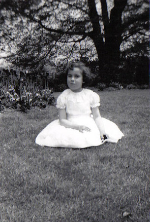 This is me on my 1st Communion Day - Note: the unruly hair is not a recent phenomena. May 1958 Roger William's Park, Providence, RI