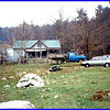 Granny and Paw's mountain farm. This represents a dying way of life. Not many left of this kind.<br /> You can see how steep the terrain is. When you look out the kitchen window you are looking out at a STEEP bank.  Ain't no backyard!  You can see my Uncle J.T.'s blaze orange cap in the far right.  The men are standing around smoking and jawing.  Remind me to tell you a story about how Paw got his drivers license.