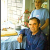 Granny and Paw.  Troy and Evelyn Painter.  He has passed on but she is still living and is 86.  <br /> This was taken on Paw's birthday. I don't recall exactly how old he was this day, but up in his mid 70's.  He was still farming full force after retiring from the Forestry service.  He was their stone mason for years and did forestry service maintenance.   He farmed by raising cattle, pigs, horses, and kept a tater patch of 1 acre and  a 2 acre vegetable garden. He and Granny had their own apple orchard.  They didn't go to the store for butter, eggs, bread, milk, cream, meat or vegetables, fruit. All grown at home. Only went for the things they couldn't grow or make themselves until the 1990s.  When this was taken he was still opening up the ground with an stout Irish dobby he raised up from a colt and used an old harrow and harness.