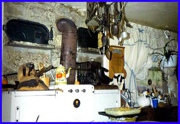 Granny's big old wood cook stove in her kitchen.  This is at Irish Creek up in the Blue Ridge Mountains of Virginia.  Paw was an expert stone mason for the CCC and built this house and did all the rock work for the chimneys and walls. Scots-Irish descent. Campbells, Grants, and on the other side.. Painters.