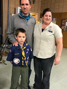 Miller, Neill and Amanda .  Miller moved up to the next rank of Cub Scouts.