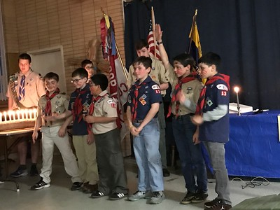 Carson's (second from right) group as they begin to give the Scout Pledge