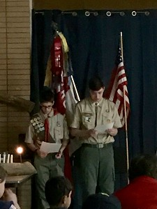 Austin and an older Scout helped with the ceremony.
