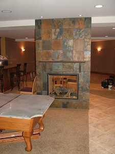 Turning immediately left off the stairs is this view- pool table area, then bar area, then home theater