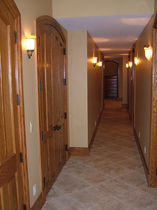 Look from end of hallway towards stairway to main floor