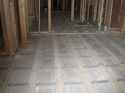 View of in floor heating for one of basement bedrooms.