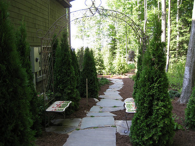 Walkway on east side of house leading to backyard (with arbor archway)