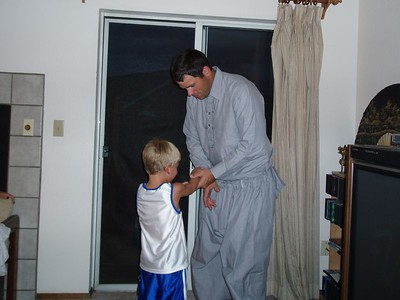 Steve's brother Bob trying on his Pakistan outfit.  His son Adam helping!
