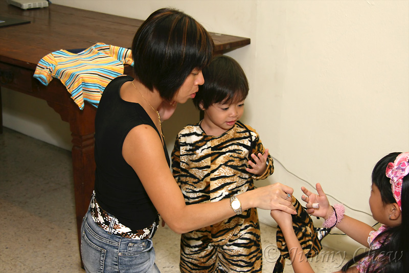 Mommi dressing up Max the Tiger.