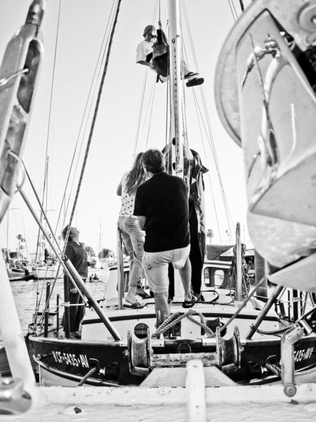 Theo in the bosun's chair, Mark, Nic, Nathalie preparing for sail.
