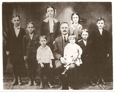 Girls: Agnes on left, Mary on right, baby Anne in father's lap Boys, left to right,: John, Henry, Ed, Phillip, William (Bill)  Approximately 1920 - Agnes would have been 14 which is about the age she was when she ran away from home.