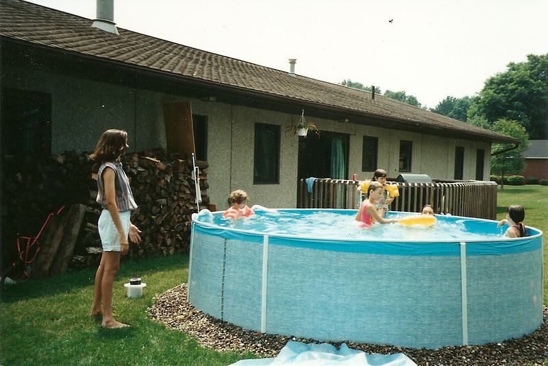 Catherine overseeing the activity in Bob's neighbors' pool   7/93
