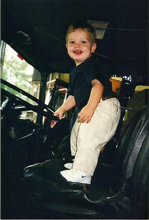 Caleb in the drivers seat of the fire truck     7/98   (one of my favorite pix of Caleb)