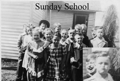 Sunday School Class taken between the current church and the house that used to sit just west of it. I am not sure of the year, but probably very late 40's or very early 50's.  front row: Mary Thuestad, Ruth McQueen, Larry Heal middle row: Marlene Gunn, Janice Gilmore, Connie Horton, Rod McQueen, Lee Clegg  back row: Unknown, John Scofield (in hat), Richard Berg, David Montgomery, Chuck Rand, Roger Gustafson.