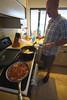 Curtis works the AM kitchen magic.