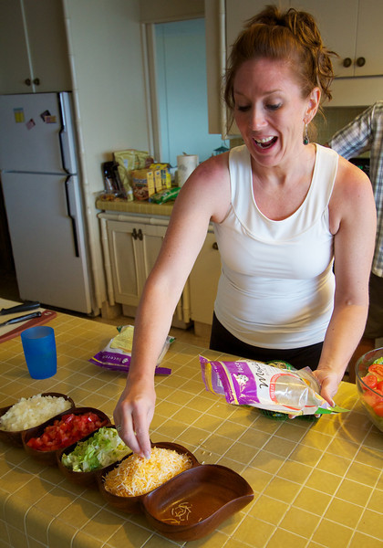 Ann contributes to the tacos.  Good finger flair.