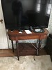 wide screen TV and table