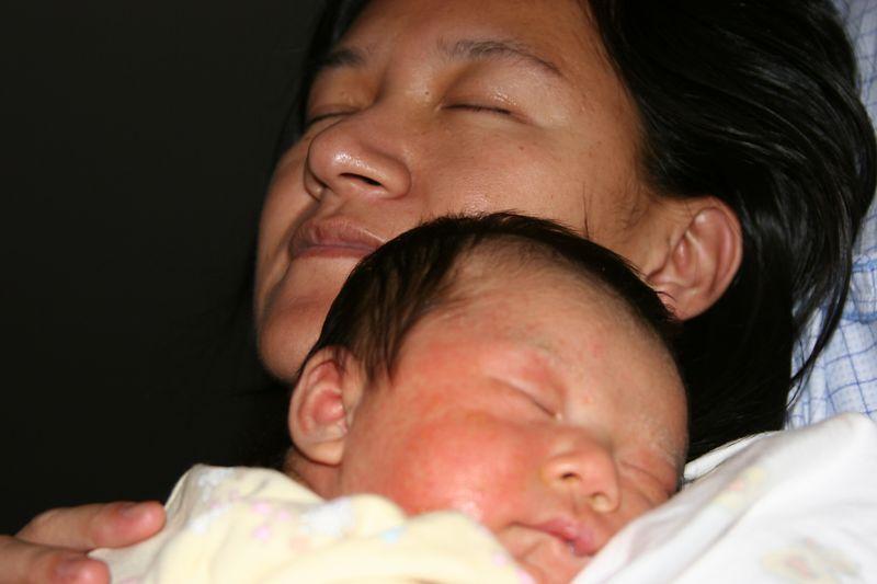 Proud Mom, Lan, holding Lydia.