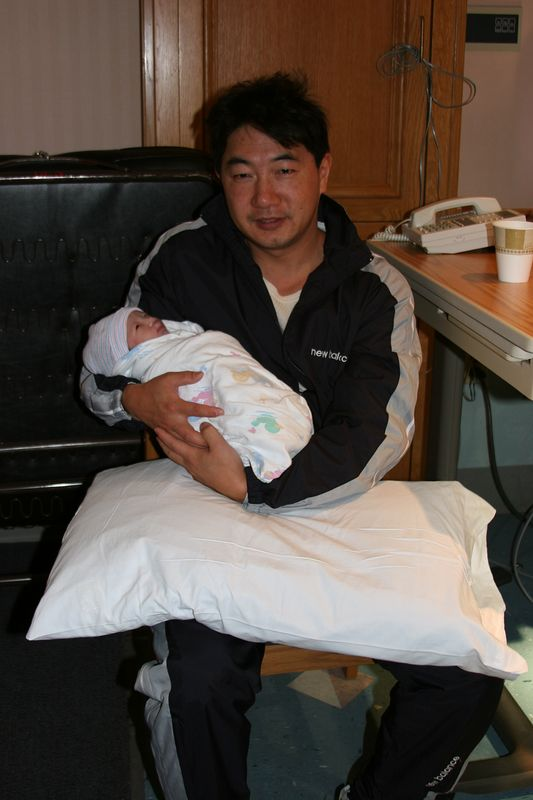 My brother Joel holding his new baby daughter.