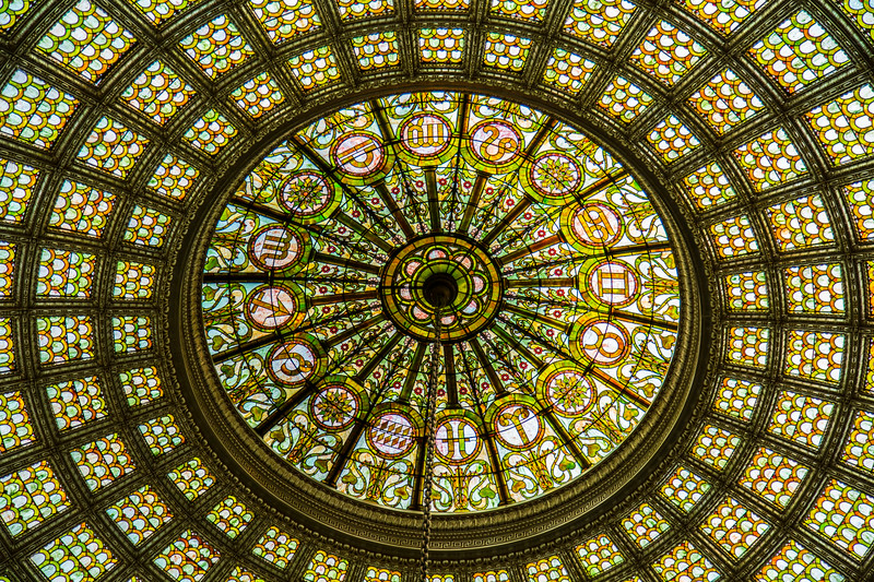 The magnificent translucent dome, 38 feet in diameter and made of Tiffany Favrile glass, is cut in the shape of fish scales. At the top of the dome are the signs of the zodiac.