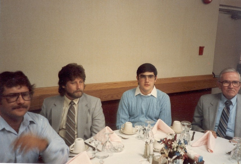 This was at my Grandma and Grandpa Fornel's 60th Anniversary party.  I don't remember the exact date, but since I'm wearing glasses here, I'm guessing it's around the end of 1987 or early in 1988.  That's my cousin Wayne on the far left, Robert between he and I, and Earl Law on the far right.