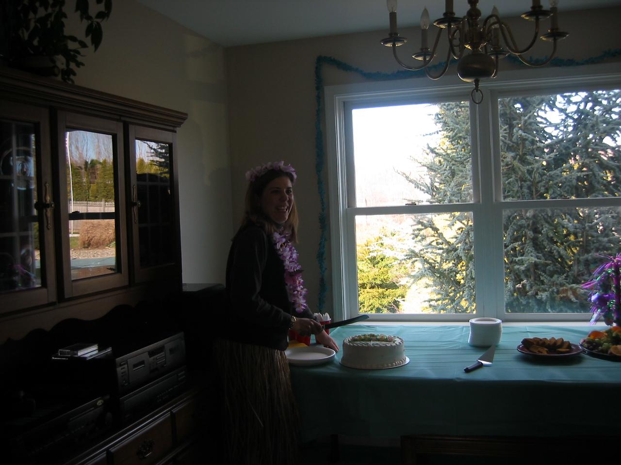 Ilsa cutting the cake