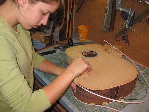 Lydia building guitar, 17 yrs.