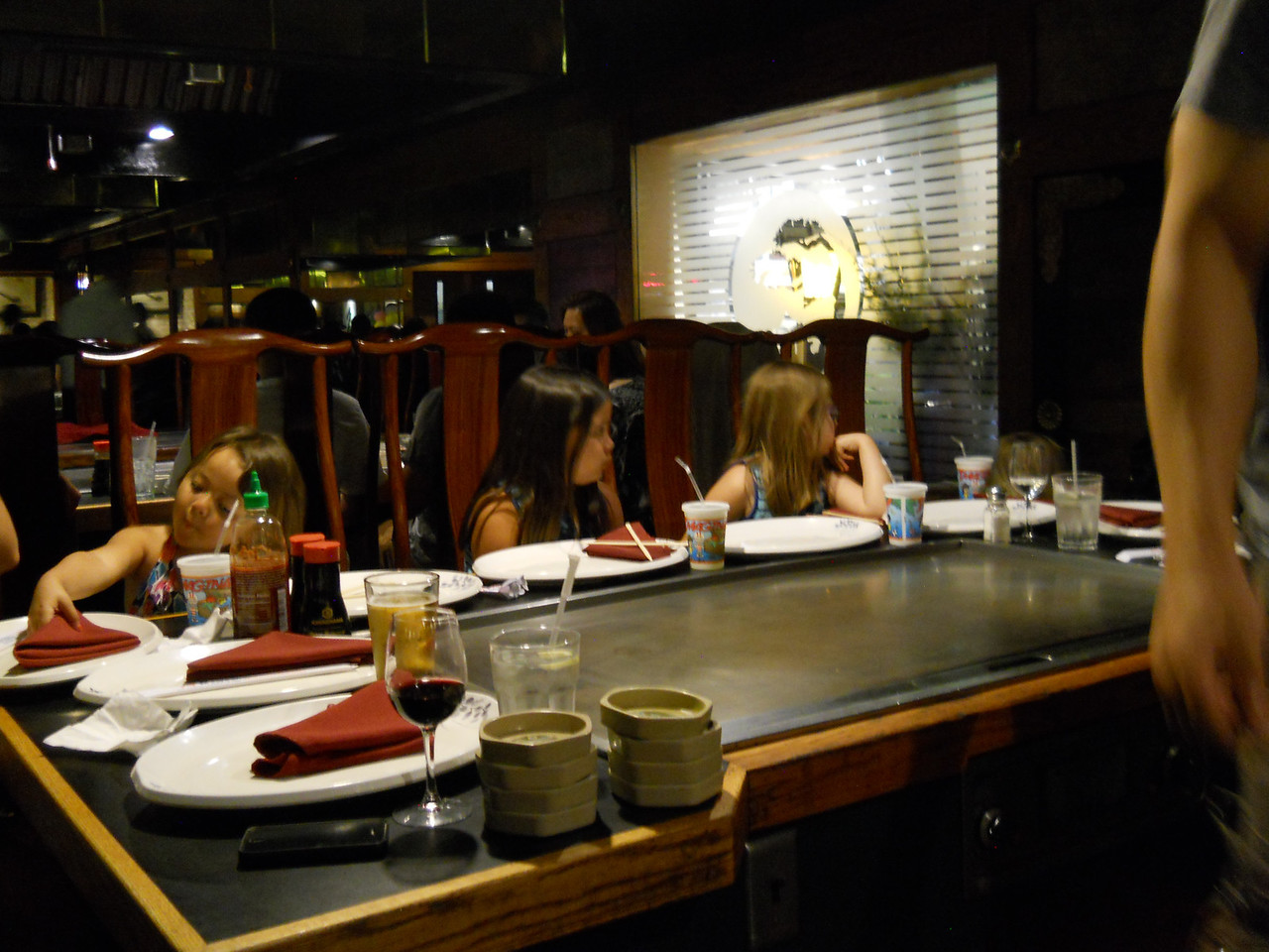 Kaidyn and Anna along with Alexa (all 3 and Katrina were flower girls) at the Rehearsal Dinner.  The girls were fascinated.  It was a Japanese Hibachi restaurant