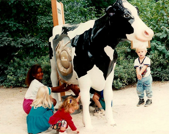 "Charlotte,Trudy, Lydia, & Andrew ""milking"" a cow at Phila. Zoo, 1992?"
