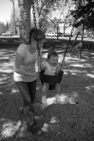 Aunt Jen gives Peyton a push on the swing at Royer park before the guests arrive.