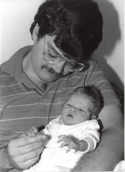 Rob with Trudy as a newborn