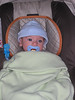 Finn in his carseat wearing the outfit from Kim Lyman