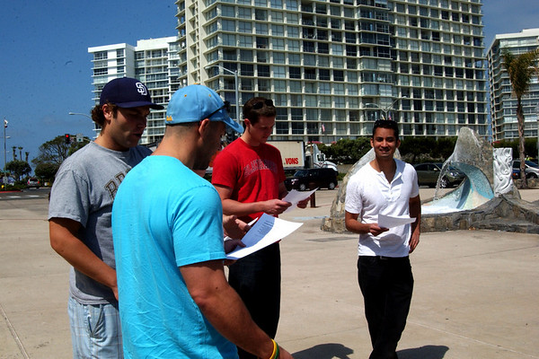 Chris & the guys figuring out their instructions