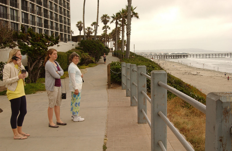 Our first glance at the Pacific; Bride-to-be still organizing stuff on cell phone!