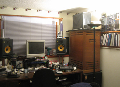 Chris's desk and the Leslie speaker (wooden cabinet) for his Hammond organ.