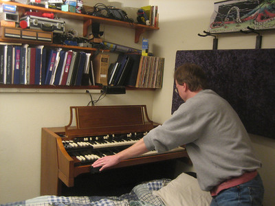 Chris demonstrated his organ (crawling over the futon bed set up for me in his music room)