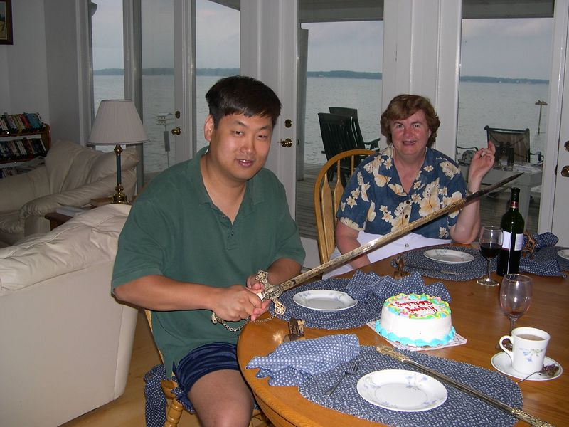 Chris prepares to cut his birthday cake with the traditional Westin birthday sword.