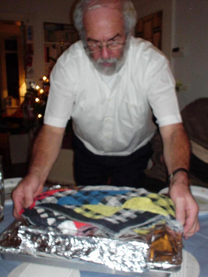 My dad carrying in the oven tray with Chicken Provençale