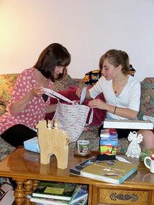 DD and Annie look at Annie's purse from Ari